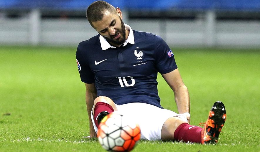 FILE - In this Oct.8, 2015 file photo, France's Karim Benzema, grimaces during the friendly soccer match against Armenia, in Nice, southeastern France.  Benzema has been charged Thursday Nov.5, 2015 with conspiracy to blackmail and participating in a criminal group as part of an investigation over a sex tape involving teammate Mathieu Valbuena (AP Photo/Lionel Cironneau, File)