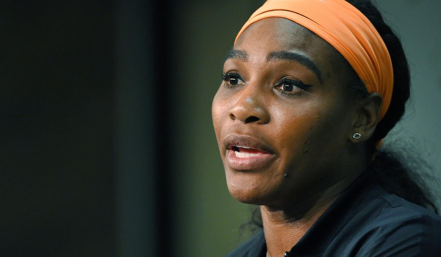 FILE - In this March 20, 2015, file photo, Serena Williams speaks during a news conference after withdrawing from her match against Simona Halep, of Romania, due to a knee injury at the BNP Paribas Open tennis tournament  in Indian Wells, Calif. San Francisco police are asking tennis star Williams to file a police report after she said someone tried to steal her cellphone at a restaurant. Officer Grace Gatpandan said Williams had not filed a report as of Thursday morning, Nov. 5, 2015. She said police like to know if they're dealing with a serial cellphone thief.  (AP Photo/Mark J. Terrill, File)