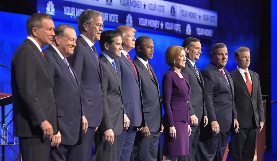 In this photo taken Oct. 28, 2015, Republican presidential candidates, from left, John Kasich, Mike Huckabee, Jeb Bush, Marco Rubio, Donald Trump, Ben Carson, Carly Fiorina, Ted Cruz, Chris Christie, and Rand Paul take the stage during the CNBC Republican presidential debate at the University of Colorado, in Boulder, Colo. (AP Photo/Mark J. Terrill) ** FILE **