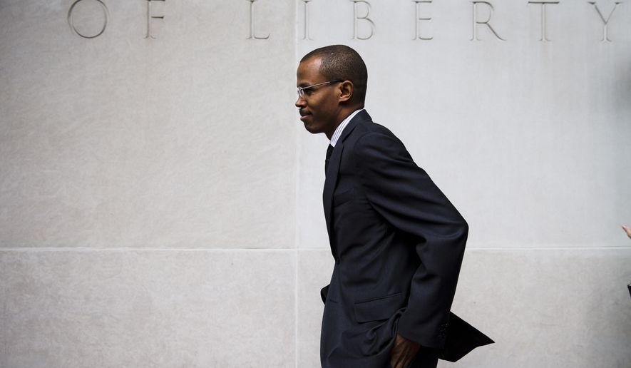 In this Aug. 14, 2014 file photo, Chaka Fattah Jr., walks from the U.S. Courthouse in Philadelphia. Fattah Jr., the son of a veteran Philadelphia congressman, was convicted Thursday, Nov. 5, 2015, of 22 of 23 counts that he misspent loans and some of the nearly $1 million in education funds he got as a school management subcontractor. (AP Photo/Matt Rourke, File)