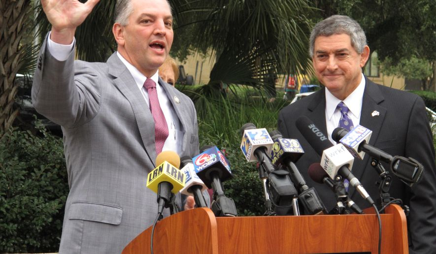 Democratic candidate for governor John Bel Edwards, left, speaks after Republican Lt. Gov. Jay Dardenne, right, announced his endorsement of Edwards in the Louisiana governor's race,Thursday, Nov. 5, 2015, in Baton Rouge, La. Dardenne, who ran fourth in the primary, chose Edwards over Republican contender David Vitter in the runoff election. (AP Photo/Melinda Deslatte)
