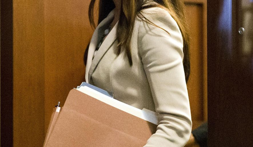 Pennsylvania Attorney General Kathleen Kane departs after a hearing Thursday, Nov. 5, 2015, at the Pennsylvania Judicial Center in Harrisburg, Pa. Judge John Cleland ordered Kane to attend a closed-door hearing to be questioned under oath about any leaks by prosecutors or a judge of secret grand jury material from the child sexual abuse investigation of former Penn State assistant football coach Jerry Sandusky. (AP Photo/Matt Rourke)