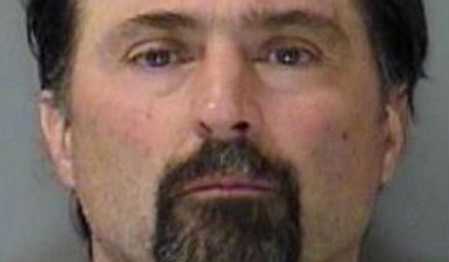 """FILE - This undated file photo provided by the Yellowstone County Detention Facility shows William Krisstofer Wolf in Billings, Mont. Jurors on Thursday, Nov. 5, 2015, convicted the anti-government activist from Montana who authorities said sought out high-powered weaponry for a coming """"second American revolution.""""  (Yellowstone County Detention Facility/The Billings Gazette via AP, File)"""