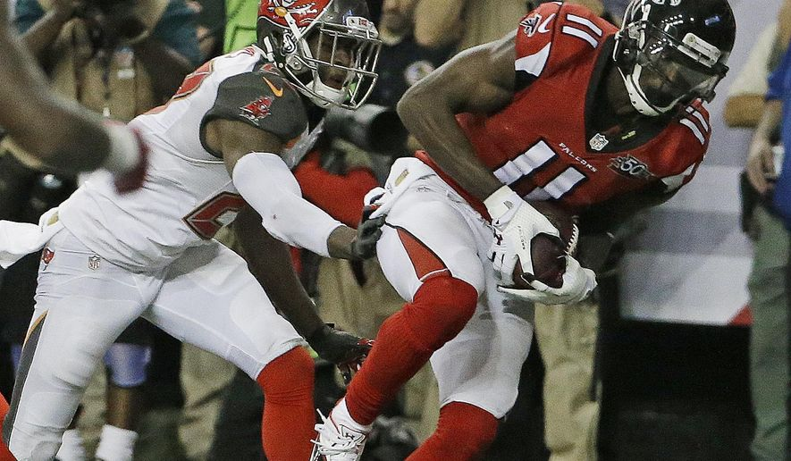 Atlanta Falcons wide receiver Julio Jones (11) makes a catch for a touchdown against Tampa Bay Buccaneers cornerback Johnthan Banks (27) during the second of an NFL football game, Sunday, Nov. 1, 2015, in Atlanta. (AP Photo/David Goldman)