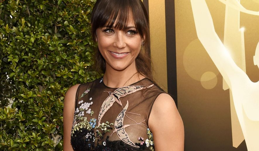 "FILE - In this Sept. 12, 2015 file photo, Rashida Jones arrives at the Creative Arts Emmy Awards in Los Angeles. Jones will star in the TBS comedy ""Angie Tribeca."" The zany police procedural will let viewers binge-watch its entire first season by airing all 10 half-hour episodes from start to finish not once, but five times in a row, commercial free. This 25-hour marathon begins Sunday, Jan. 17.  (Photo by Chris Pizzello/Invision/AP, File)"