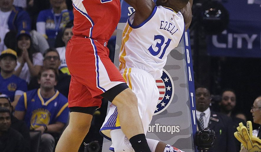 Los Angeles Clippers' Blake Griffin, left, blocks a shot by Golden State Warriors' Festus Ezeli (31) during the first half of an NBA basketball game Wednesday, Nov. 4, 2015, in Oakland, Calif. (AP Photo/Ben Margot)