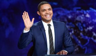 "In this Sept. 29, 2015, file photo, Trevor Noah gestures on the set during a taping of ""The Daily Show with Trevor Noah"" in New York. One day after an emergency appendectomy, Trevor Noah was expected back at his ""Daily Show"" anchor desk, taping a new episode set to air Thursday night.  (Photo by Evan Agostini/Invision/AP, File)"
