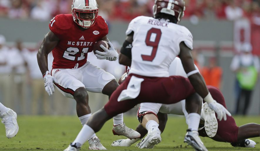FILE - In this Sept. 5, 2015, file photo, North Carolina State's Matt Dayes (21) looks for some room to run during an NCAA college football game against Troy in Raleigh, N.C. Dayes is out for the rest of the season with a foot injury. The school announced the injury Thursday, Nov. 5, saying Dayes would have surgery Friday for the injury sustained in last weekend's loss to No. 3 Clemson. (AP Photo/Gerry Broome, File)