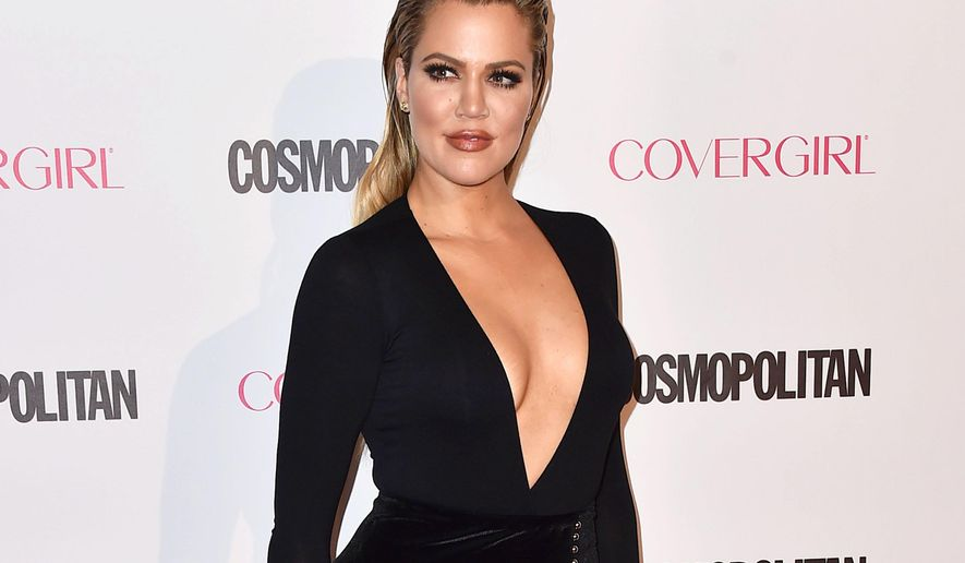 "FILE - In this Oct. 12, 2015 file photo, Khloe Kardashian arrives at Cosmopolitan magazine's 50th birthday celebration in West Hollywood, Calif. Kardashian's new talk show ""Kocktails with Khloe"" will premiere on Jan. 20 on theFYI channel. Taped in a Los Angeles studio, it will be the gathering place for celebrity friends and family, who will join her on a set that replicates a home environment. (Photo by Jordan Strauss/Invision/AP, File)"