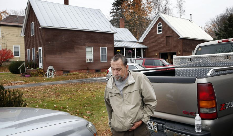 Paul Seluke, the landlord who lives at the back of the house where two women and a man were shot to death in Oakland, Maine, leaves after a brief visit to the scene, Thursday, Nov. 5, 2015. Police say the gunman shot himself outside the residence and was found in the driveway. (AP Photo/Robert F. Bukaty)