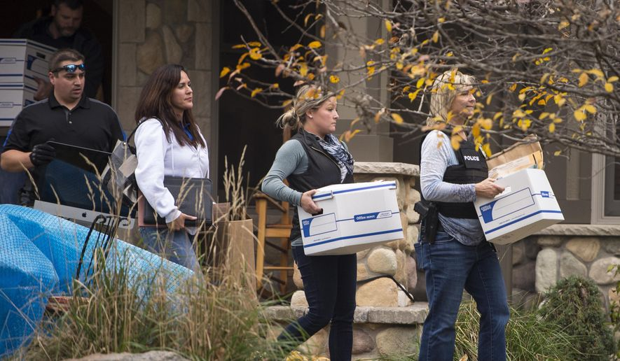 Law enforcement leave the home of former Starkey Hearing Technologies President Jerry Ruzicka carrying evidence including a computer and boxes of documents Wednesday afternoon, Nov. 4, 2015, in Plymouth, Minn.  (Aaron Lavinsky /Star Tribune via AP)  MANDATORY CREDIT; ST. PAUL PIONEER PRESS OUT; MAGS OUT; TWIN CITIES LOCAL TELEVISION OUT