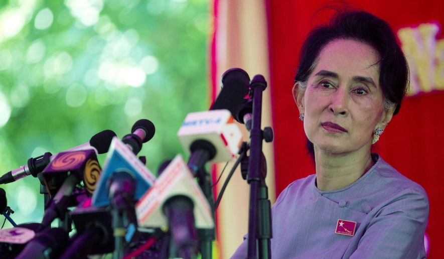 Myanmar's opposition leader Aung San Suu Kyi addresses the media at a press conference at her home in Yangon, Myanmar, Thursday, Nov. 5, 2015. On Sunday Myanmar will hold what is being viewed as the country's best chance for a free and credible election in a quarter of a century.(AP Photo/Mark Baker)