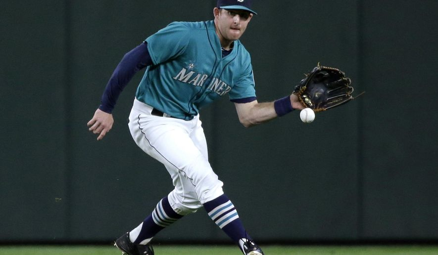FILE - In this Oct. 2, 2015, file photo, Seattle Mariners' Brad Miller fields a ball duirng a baseball game against the Oakland Athletics in Seattle. The Mariners and the Tampa Bay Rays have completed the first significant trade of the offseason, a six-player swap that sends Miller, first baseman Logan Morrison and pitcher Danny Farquhar to Tampa Bay for pitchers Nathan Karns and C.J. Riefenhauser, and minor league outfielder Boog Powell. The teams announced the deal Thursday night, Nov. 5. (AP Photo/Elaine Thompson, File)