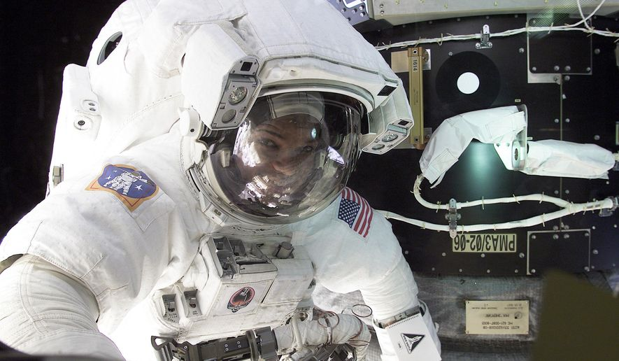 "In this Feb. 12, 2001 photo released by the Science Channel, astronaut Robert L. Curbeam is pictured during a space walk. Curbeam is featured, along with other former astronauts on the Science Channel's series ""Secret Space Escapes,"" premiering Nov. 10 at 10 p.m. ET. (NASA/Science Channel via AP)"