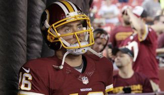 Washington Redskins quarterback Colt McCoy (16) waits in the tunnel before an NFL preseason football game against the Jacksonville Jaguars in Landover, Md., Thursday, Sept. 3, 2015. (AP Photo/Mark Tenally)