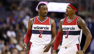 Washington Wizards guards John Wall (2) and Bradley Beal (3) talk in the second half of an NBA basketball game against the San Antonio Spurs, Wednesday, Nov. 4, 2015, in Washington. The Wizards won 102-99. (AP Photo/Alex Brandon)