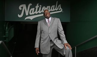 Dusty Baker poses for a picture after a news conference to present him as the new manager of the Washington Nationals baseball team, Thursday, Nov. 5, 2015, in Washington. (AP Photo/Alex Brandon)