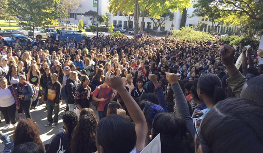 """Berkeley High School students who walked out of class hold a protest in reaction to reports of racist slurs found the day before on a school library computer in Berkeley, Calif., Thursday, Nov. 5, 2015. The message referred to the KKK, using derogatory language related to African Americans and threatening a """"public lynching"""" on Dec. 9. (Laura A. Oda/Bay Area News Group via AP)"""