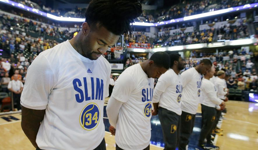 Indiana Pacers' Jordan Hill pauses during the playing of the national anthem before the start of an NBA basketball game against the Boston Celtics, Wednesday, Nov. 4, 2015, in Indianapolis. Players on both teams wore shirts honoring former Indiana Pacers Hall of Famer Mel Daniels who passed away last week. (AP Photo/Darron Cummings)