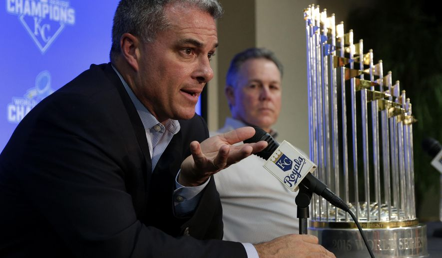 Kansas City Royals general manager Dayton Moore, left, and manager Ned Yost speak to members of the media with their World Series trophy during a news conference wrapping up the team's season Thursday, Nov. 5, 2015, in Kansas City, Mo. The Royals capped their season by defeating the New York Mets in five games to win baseball's World Series. (AP Photo/Charlie Riedel)