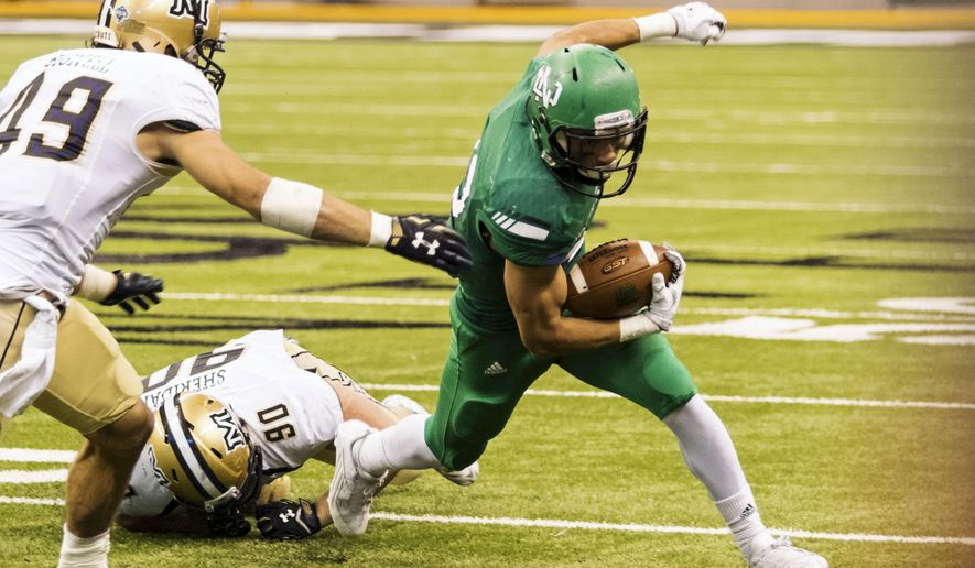 In this Oct. 31, 2015 photo, provided by University of North Dakota Athletics, North Dakota freshman running back John Santiago rushes against Montana State during an NCAA college football game in Grand Forks, N.D. Santiago is the fifth leading rusher in the Football Championship Subdivision and the only first-year player among the top 30. He ran for 230 yards and three touchdowns to spark an upset of Montana State. (Tyler Ingham/University of North Dakota Athletics via AP)