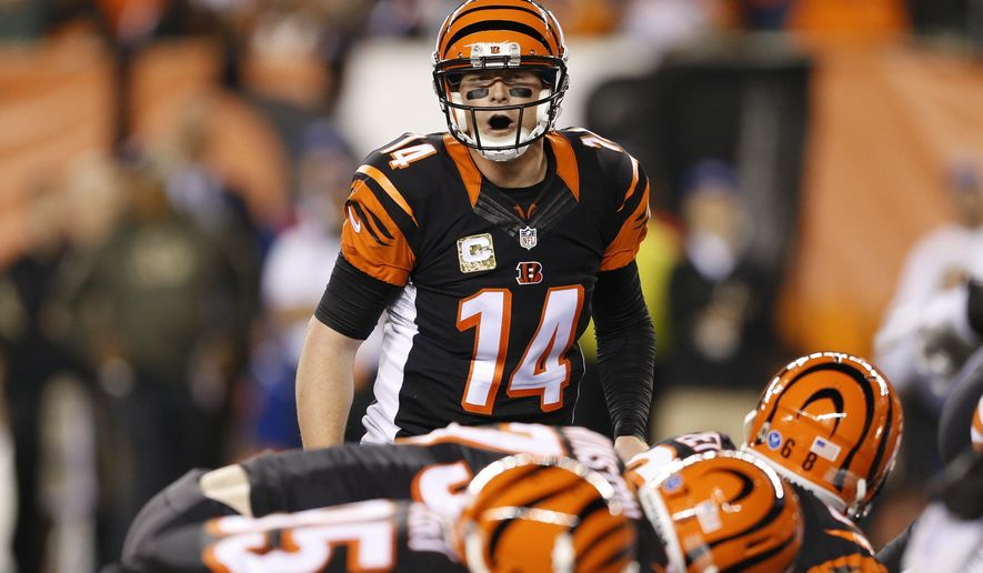 Cincinnati Bengals quarterback Andy Dalton (14) calls out signals at the line of scrimmage during the first half of an NFL football game against the Cleveland Browns, Thursday, Nov. 5, 2015, in Cincinnati. (AP Photo/Gary Landers)