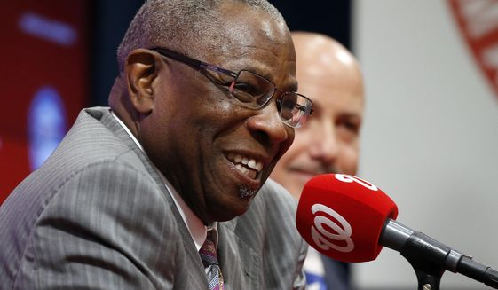 Dusty Baker, left, smiles, with general manager Mike Rizzo, during a news conference to present Baker as the new manager of the Washington Nationals baseball team, Thursday, Nov. 5, 2015, in Washington. (AP Photo/Alex Brandon)