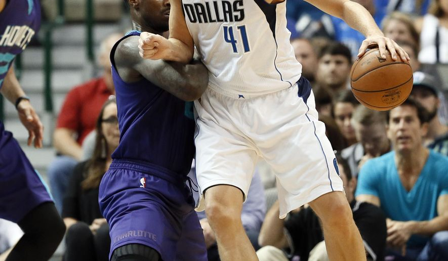 Charlotte Hornets' Marvin Williams (2) defends Dallas Mavericks' Dirk Nowitzki (41) during the first half of an NBA basketball game Thursday, Nov. 5, 2015, in Dallas. (AP Photo/Tony Gutierrez)