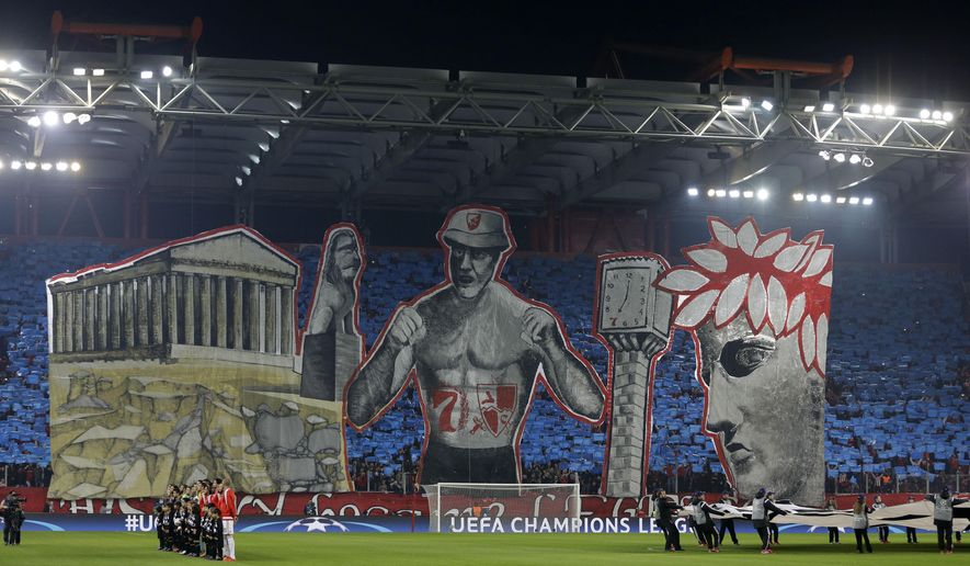 Olympiakos fans hold up a giant banner depicting landmarks of the city before the Champions League Group F soccer match between Olympiakos and Dinamo Zagreb at the Georgios Karaiskakis stadium in Piraeus port, near Athens, Wednesday, Nov. 4, 2015. (AP Photo/Thanassis Stavrakis)
