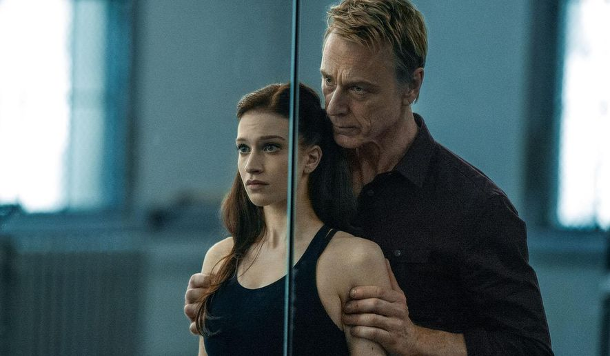 """This image released by Starz shows Sarah Hay, left, and Ben Daniels in a scene from """"Flesh and Bone,"""" premiering on Sunday, Nov. 8, 2015 on Starz. (Patrick Harbron/Starz via AP)"""