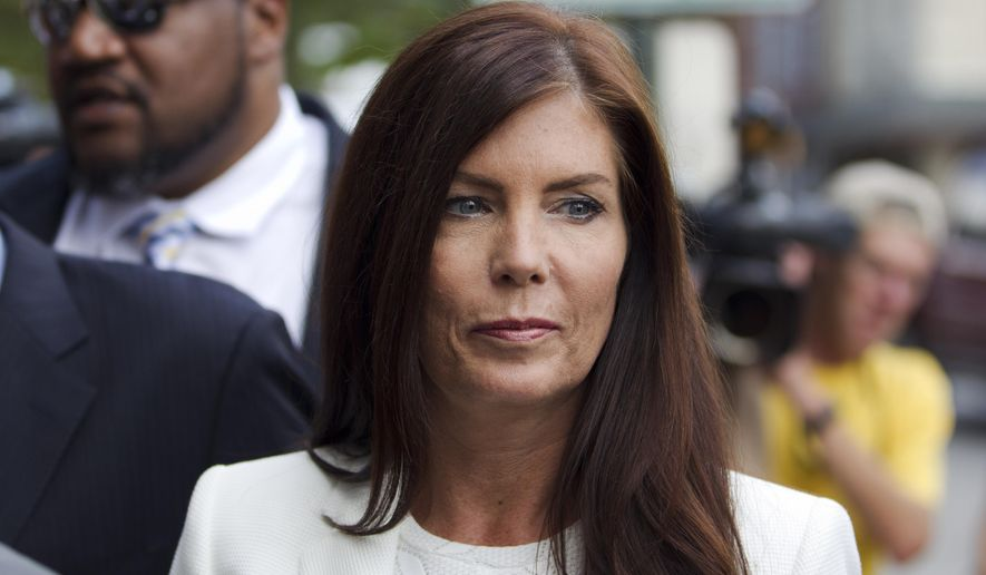 FILE - In this Aug. 8, 2015, file photo, Pennsylvania Attorney General Kathleen Kane arrives to be arraigned on charges she leaked secret grand jury material and then lied about it under oath at the Montgomery County detective bureau in Norristown, Pa. The Pennsylvania Supreme Court's temporary suspension of Kane's law license began Thursday, Oct. 22, 2015, and a day later, state senators outlined plans for a bipartisan committee to determine whether Kane should be removed from office. (AP Photo/Laurence Kesterson, File)