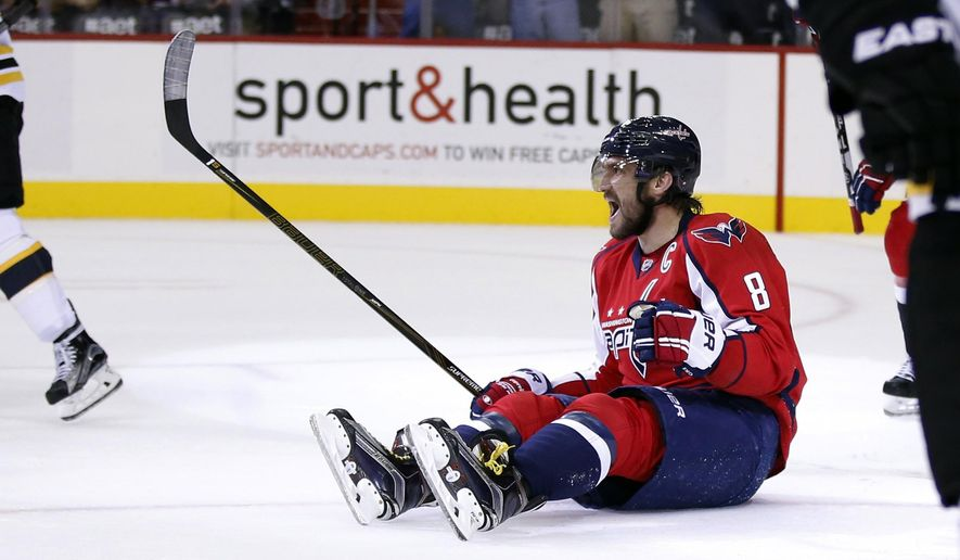 Washington Capitals left wing Alex Ovechkin, from Russia, celebrates his goal during the first period of an NHL hockey game against the Boston Bruins, Thursday, Nov. 5, 2015, in Washington. (AP Photo/Alex Brandon)