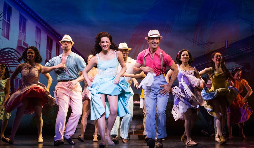 "This image released by Vivacity Media Group shows Ana Villafane, center, as Gloria Estefan in the musical ""On Your Feet!"" (Matthew Murphy/Vivacity Media Group via AP)"