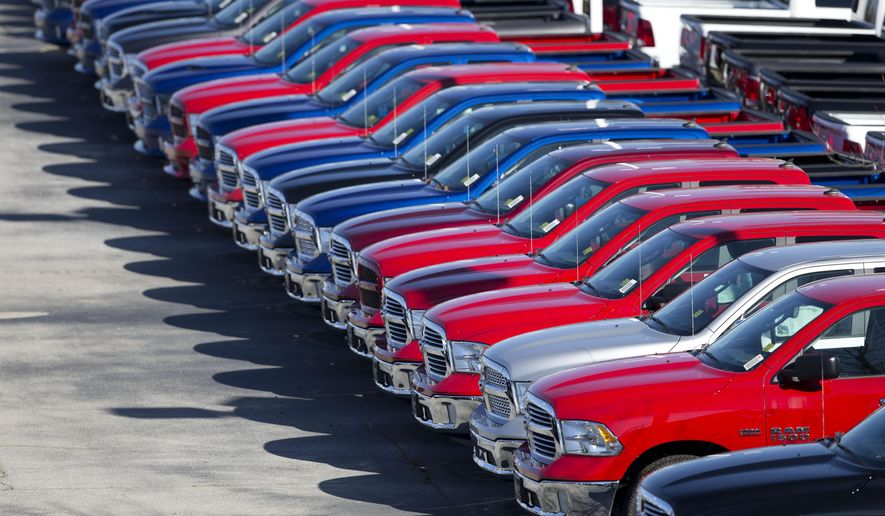 FILE - In this Jan. 5, 2015, file photo, Dodge Ram pickup trucks are on display on the lot at Landmark Dodge Chrysler Jeep RAM in Morrow, Ga. Net income at Fiat Chrysler's U.S. operations fell 89 percent in the third quarter as the company set aside millions to pay for future safety recalls, Fiat Chrysler announced, Thursday, Nov. 5, 2015. (AP Photo/John Bazemore, File)
