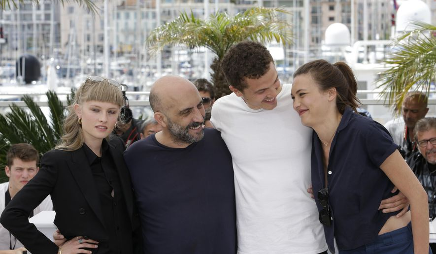 From left, actress Klara Kristin, director Gaspar Noe, actors Karl Glusman, and Aomi Muyock pose for photographers during a photo call for the film Love, at the 68th international film festival, Cannes, southern France, Thursday, May 21, 2015. (AP Photo/Lionel Cironneau)