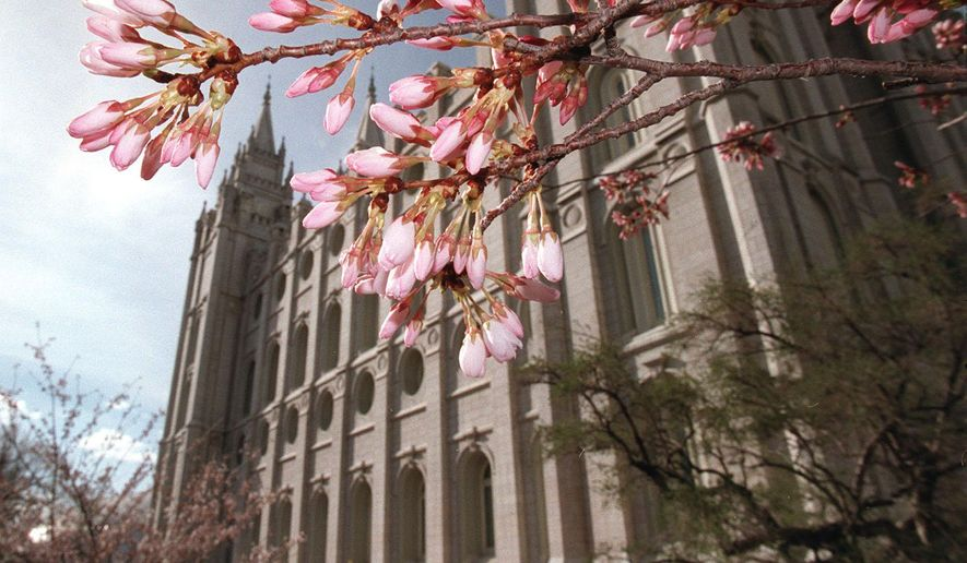 This March 31, 1998 photo shows flowering trees opening their blossoms just in time for Spring Conference on Temple Square. (Al Hartmann/The Salt Lake Tribune via AP) LOCAL STATIONS OUT; MAGS OUT; DESERET NEWS OUT; MANDATORY CREDIT DESERET NEWS OUT