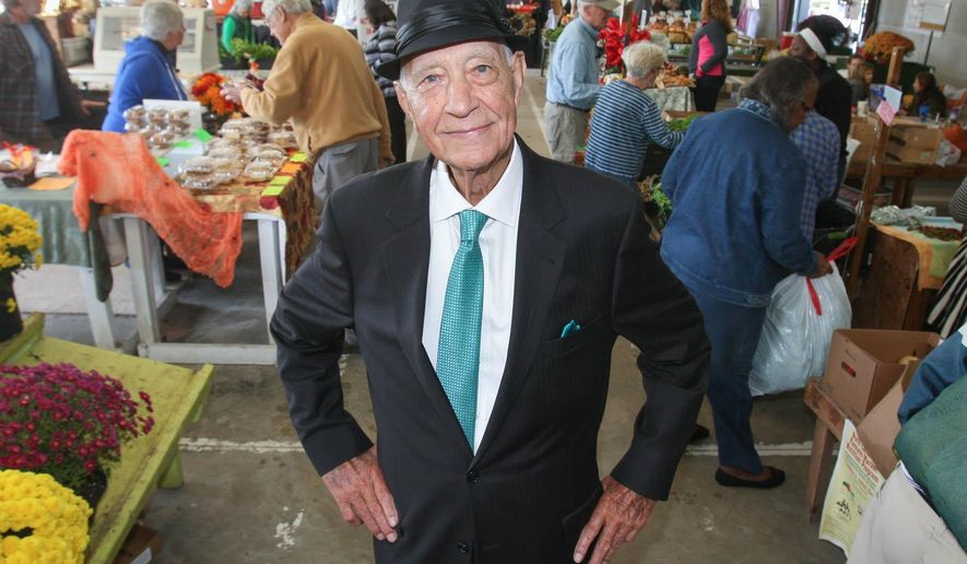 Leroy James stands in the Pitt County Farmers'  Market before a renaming ceremony in his honor on Oct. 31, 2015 in Greenville, N.C.  James worked with others to help grow Pitt County Farmers Market into great success  ( Rhett Butler /The Daily Reflector via AP) MANDATORY CREDIT