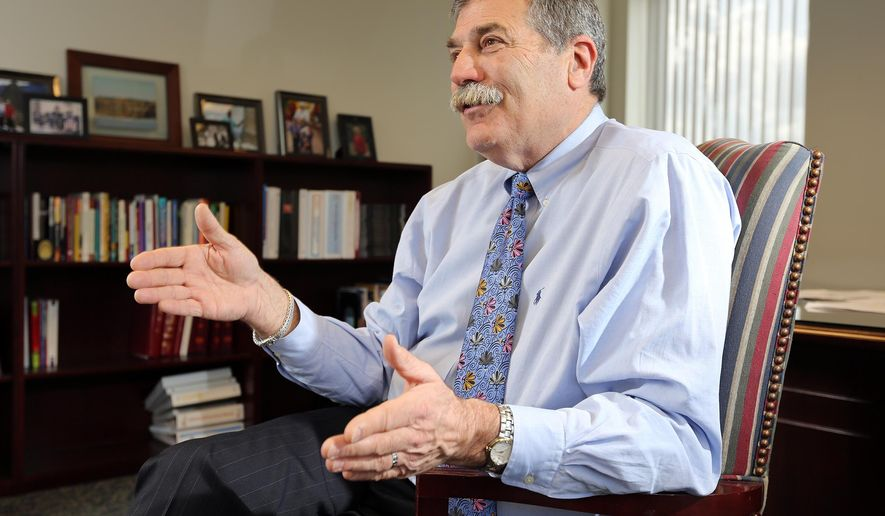 In this photo taken on March 25, 2013, State School Superintendent Richard Ross sits for an interview inside his office in the Ohio Department of Education building, in Columbus, Ohio. Ohio's public schools superintendent plans to retire at the end of the year, a move that had been delayed after a summer flap involving charter-school sponsor evaluations, Ross said Friday, Nov. 6, 2015. (Adam Cairns /The Columbus Dispatch via AP) MANDATORY CREDIT