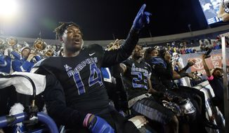 Memphis defensive end Latarius Brady (14) celebrates with teammates at the end of their NCAA college football game against Tulane in Memphis, Tenn., Saturday, Oct. 31, 2015. Memphis won 41-13. (AP Photo/Rogelio V. Solis)