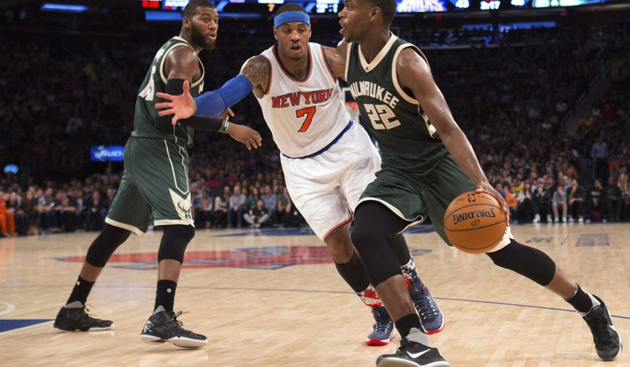 New York Knicks forward Carmelo Anthony (7) guards Milwaukee Bucks forward Khris Middleton (22) during the first half of an NBA basketball game Friday, Nov. 6, 2015, at Madison Square Garden in New York. (AP Photo/Kevin Hagen)