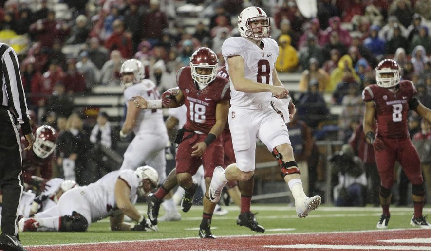 Stanford quarterback Kevin Hogan (8) runs in for a touchdown during the second half of an NCAA college football game against Washington State, Saturday, Oct. 31, 2015, in Pullman, Wash. Stanford won 30-28. (AP Photo/Young Kwak)