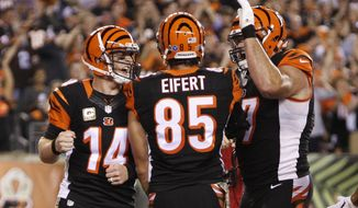Cincinnati Bengals quarterback Andy Dalton (14) celebrates a touchdown by tight end Tyler Eifert (85) during the first half of an NFL football game against the Cleveland Browns, Thursday, Nov. 5, 2015, in Cincinnati. (AP Photo/Frank Victores)