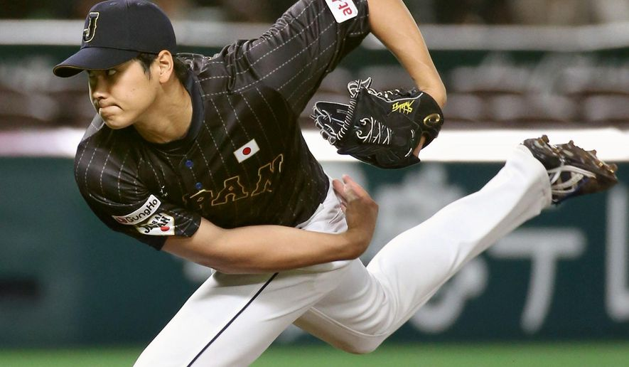 Japan's Shohei Otani delivers a pitch against Puerto Rico in their exhibition game, ahead of Premier12 baseball tournament in Fukuoka, western Japan, Thursday, Nov. 5, 2015. (Kyodo News via AP) JAPAN OUT, MANDATORY CREDIT