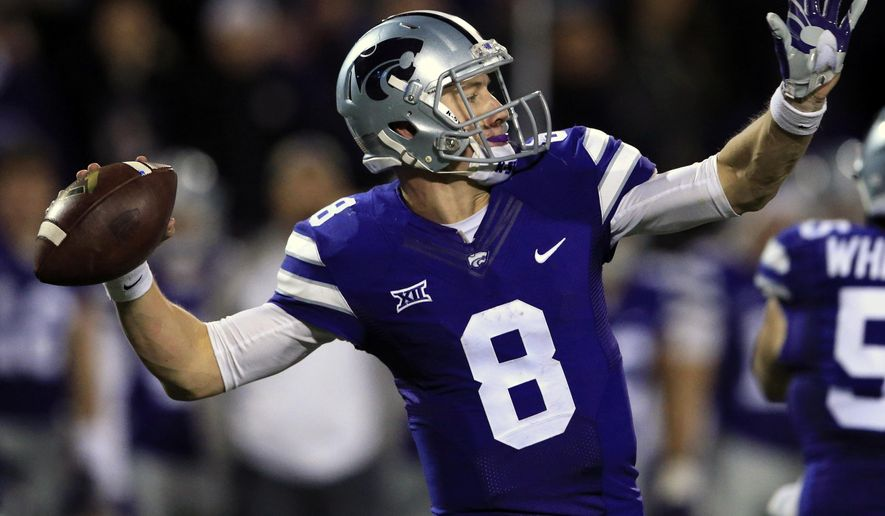 Kansas State quarterback Joe Hubener prepares to pass to a teammate during the first half of an NCAA college football game against Baylor in Manhattan, Kan., Thursday, Nov. 5, 2015. (AP Photo/Orlin Wagner)