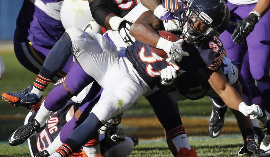 FILE - In this Nov. 1, 2015, file photo, Chicago Bears rookie running back Jeremy Langford (33) is tackled by Minnesota Vikings cornerback Captain Munnerlyn (24) during an NFL football game in Chicago. With star running back Matt Forte expected to be out of the lineup, the Bears figure to give rookie Langford a long look when they visit the San Diego Chargers on Monday night, Nov. 9, 2015. (AP Photo/Charles Rex Arbogast, File)