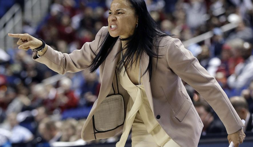 FILE - In this March 27, 2015, file photo, South Carolina coach Dawn Staley directs her team during the first half of a women's college basketball regional semifinal game against North Carolina in the NCAA Tournament Greensboro, N.C. Staley and No. 2 South Carolina are closing in on their national championship dreams. These final few steps, though _ like getting past national champion Connecticut _ could be the most challenging. (AP Photo/Gerry Broome, File)