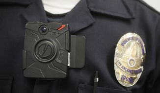 A Los Angeles Police officer wears an on-body camera during a demonstration in Los Angeles on Jan. 15, 2014. (Associated Press) **FILE**