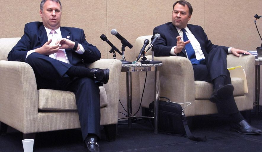 FILE - In this Feb. 12, 2015, file photo, Ohio Republican Party Chairman Matt Borges, left, and Ohio Democratic Party Chairman David Pepper speak at the Ohio Newspaper Association's annual convention in Columbus, Ohio. Borges and Pepper spoke to executives at the Cincinnati USA Regional Chamber on Friday, Nov. 6, 2015, about each party's perspective on national and state election races in 2016. (AP Photo/Andrew Welsh-Huggins, File)