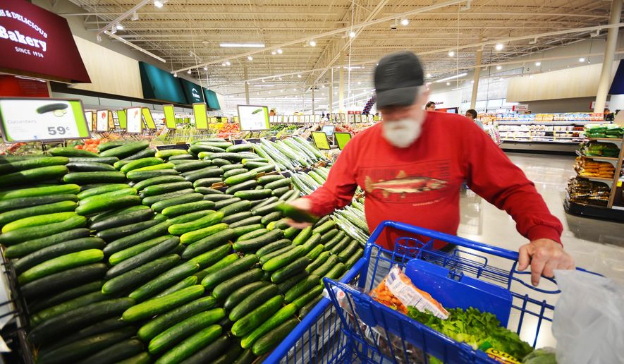 David Asch, of Kalkaska, Mich. selects produce at the Meijer store in Acme Township, Mich., on Friday, Nov. 5, 2015, during the store's opening day. (Dan Nielsen/Record-Eagle via AP)