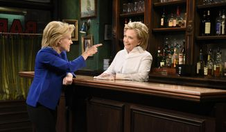 "In this Oct. 3, 2015 photo released by NBC, Kate McKinnon portrays Democratic presidential candidate Hillary Clinton, left, and Hillary Clinton portrays Val during the ""Bar Talk"" in a sketch from ""Saturday Night Live,"" in New York. Republican presidential candidate Donald Trump will host the popular late night series on Nov. 7.  (Dana Edelson/NBC via AP)"